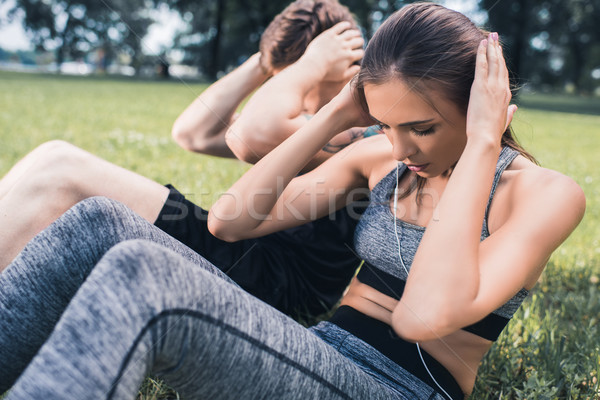 couple doing abs exercise Stock photo © LightFieldStudios