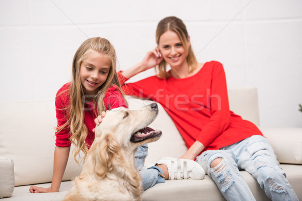 mother and daughter with dog Stock photo © LightFieldStudios