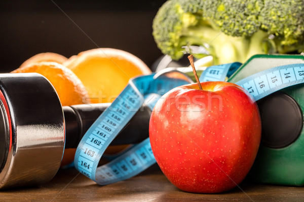 healthy food and sports equipment Stock photo © LightFieldStudios