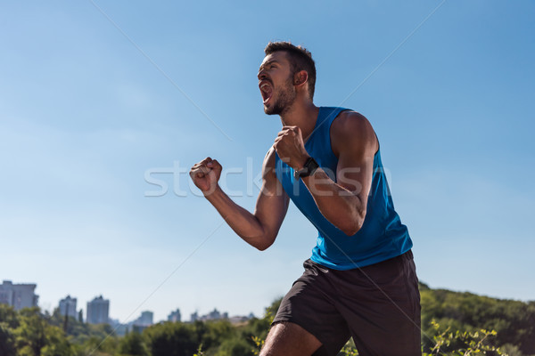 sportsman yelling and celebrating triumph  Stock photo © LightFieldStudios