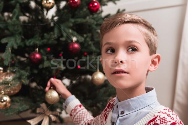 boy decorating christmas tree Stock photo © LightFieldStudios