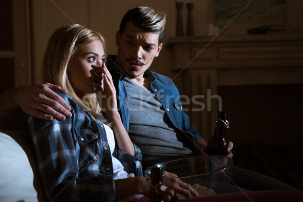 side view of frightened woman watching movie with man Stock photo © LightFieldStudios