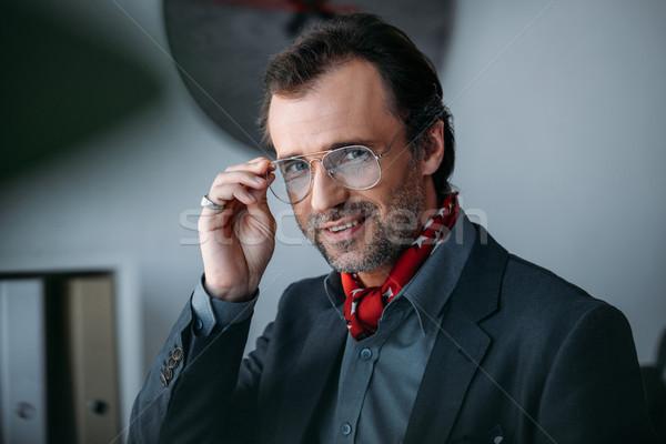 Przystojny w średnim wieku biznesmen portret okulary patrząc Zdjęcia stock © LightFieldStudios