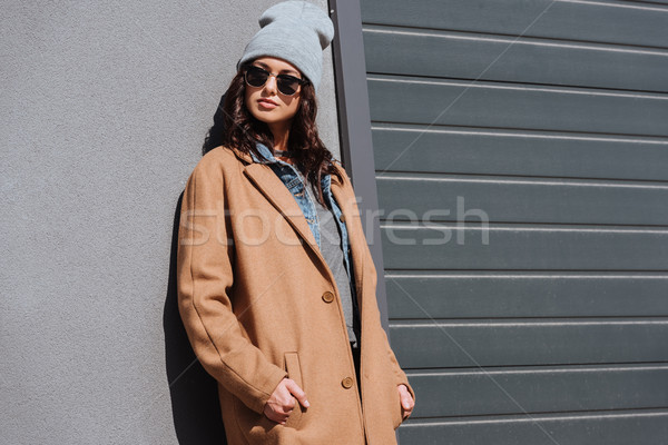 Woman in autumn outfit and black sunglasses Stock photo © LightFieldStudios