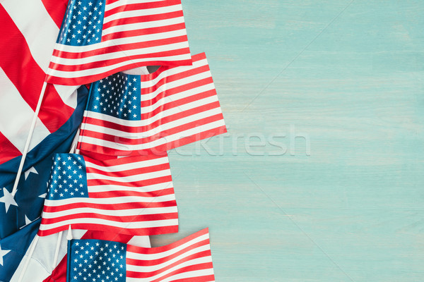 top view of arranged american flags on blue wooden tabletop, presidents day concept Stock photo © LightFieldStudios