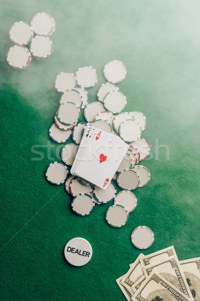 Gambling concept with with cards and chips on casino table  Stock photo © LightFieldStudios