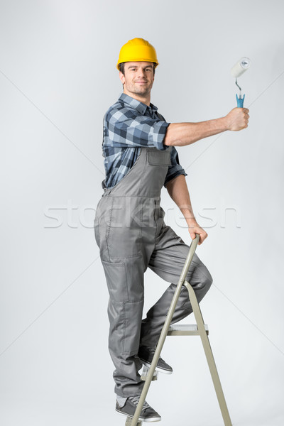 Workman with paint roller  Stock photo © LightFieldStudios