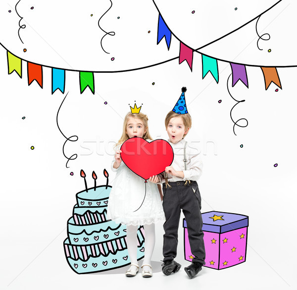 Kids holding red heart Stock photo © LightFieldStudios