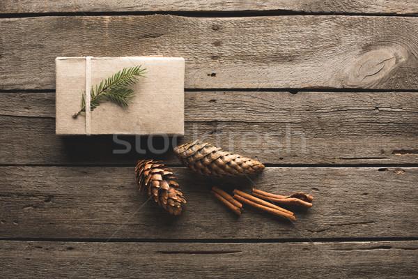 gift with pine cones and cinnamon sticks Stock photo © LightFieldStudios