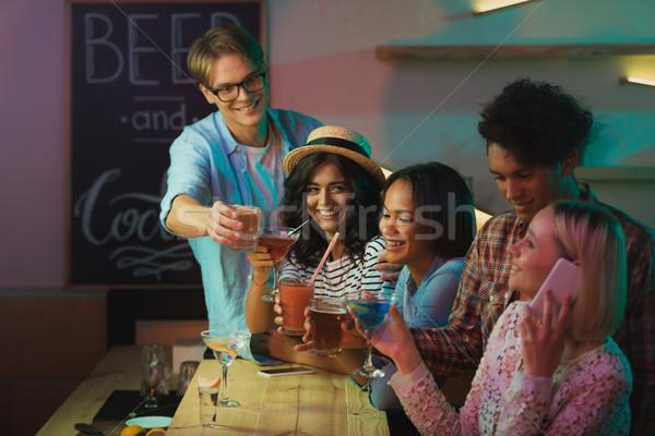 Több nemzetiségű barátok buli alkohol italok bár Stock fotó © LightFieldStudios
