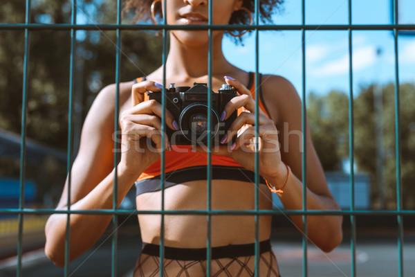 Kobieta kamery shot sportowe biustonosz stałego Zdjęcia stock © LightFieldStudios