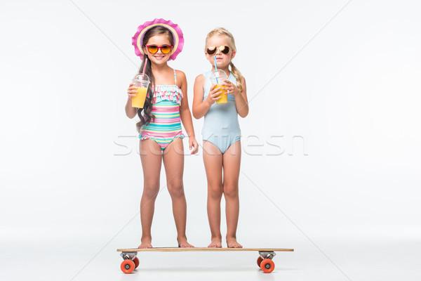 kids with skateboard and juice Stock photo © LightFieldStudios