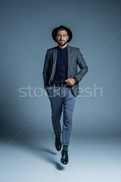 Walking man in suit and hat Stock photo © LightFieldStudios