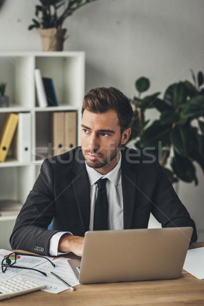thoughtful businessman with laptop Stock photo © LightFieldStudios