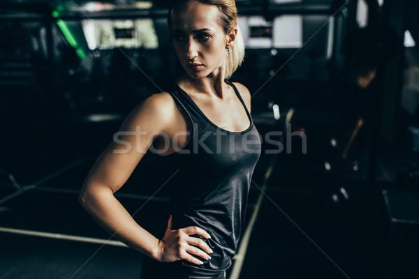 Athletic sportswoman with arms akimbo Stock photo © LightFieldStudios