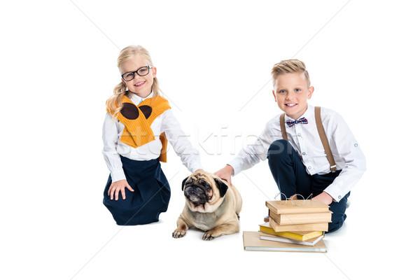 children stroking dog Stock photo © LightFieldStudios
