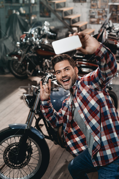 Człowiek motocykl szczęśliwy przystojny mężczyzna rock Zdjęcia stock © LightFieldStudios