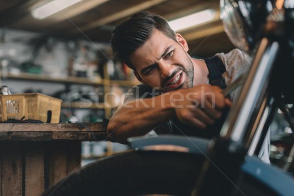 automechanic fixing motorbike Stock photo © LightFieldStudios