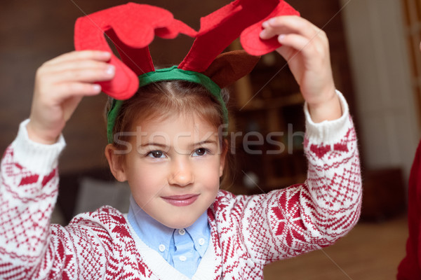 child in antlers headband Stock photo © LightFieldStudios
