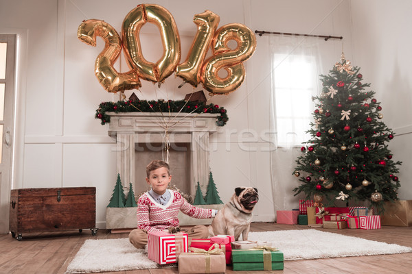 boy with dog on christmas Stock photo © LightFieldStudios