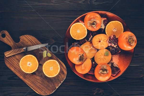 Felső kilátás gyümölcsök tányér fa deszka textúra Stock fotó © LightFieldStudios