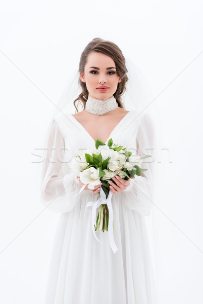 attractive bride in traditional dress and veil holding wedding bouquet, isolated on white Stock photo © LightFieldStudios