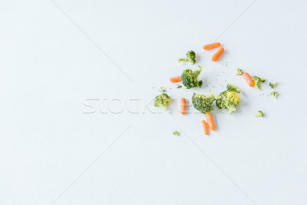 top view of fresh raw ripe carrots and broccoli on white Stock photo © LightFieldStudios