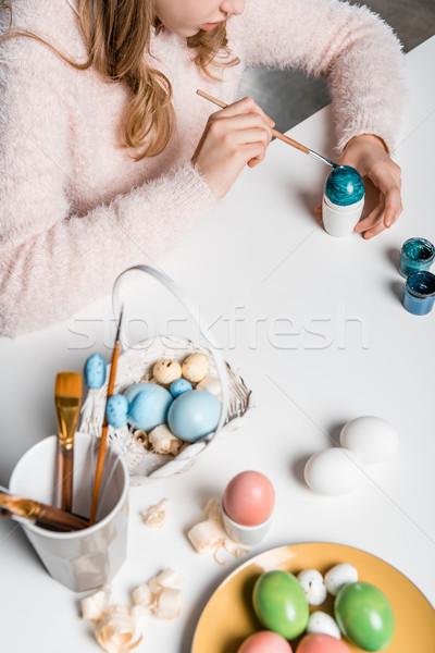 Shot adorabile bambino pittura easter eggs tavola Foto d'archivio © LightFieldStudios