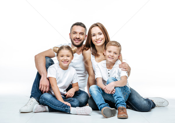 Happy family sitting together Stock photo © LightFieldStudios