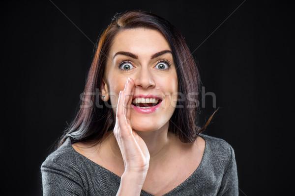 Woman telling secret Stock photo © LightFieldStudios