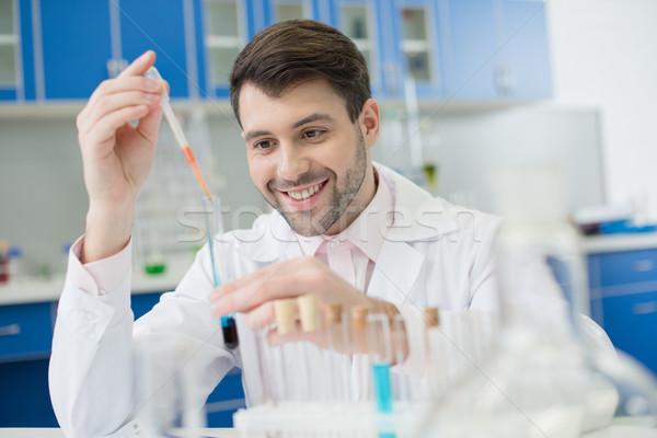 Portré mosolyog férfi tudós dolgozik kémcső Stock fotó © LightFieldStudios