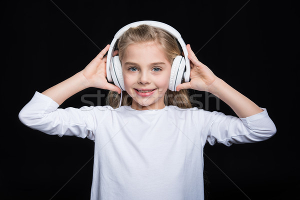 Little girl in headphones Stock photo © LightFieldStudios