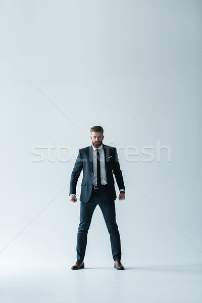 Stylish bearded businessman with clenched fists looking at camera Stock photo © LightFieldStudios