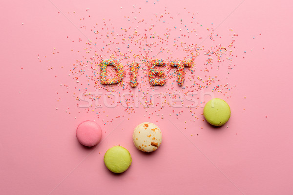 Top view of word diet made from candies isolated on pink, healthy lifestyle concept Stock photo © LightFieldStudios