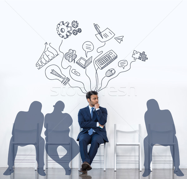 businessman in suit sitting with shadows Stock photo © LightFieldStudios