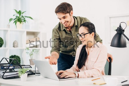 Woman leaning on man on chair Stock photo © LightFieldStudios