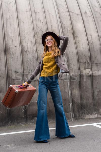 Elegancki dziewczyna hat walizkę elegancki Zdjęcia stock © LightFieldStudios