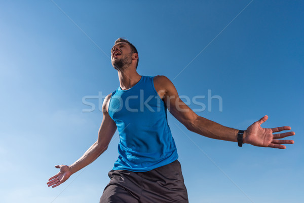 excited sportsman yelling Stock photo © LightFieldStudios