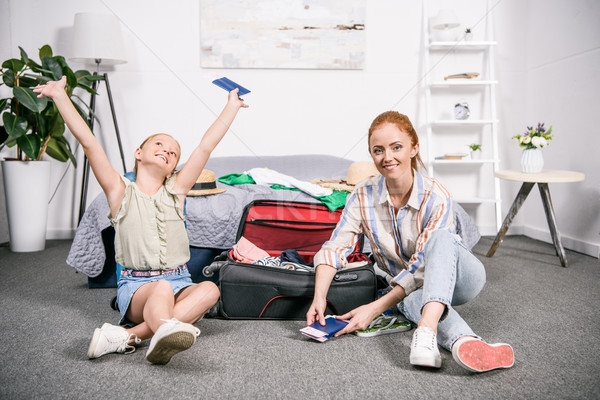 mother and daughter with luggage for trip Stock photo © LightFieldStudios