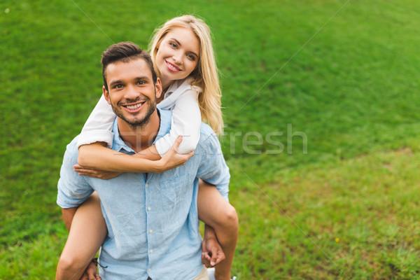 man and woman piggybacking Stock photo © LightFieldStudios