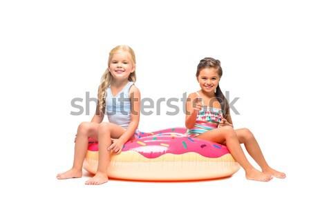 kids sitting on swim tube Stock photo © LightFieldStudios