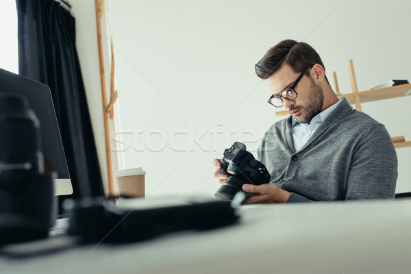 photographer working in modern office Stock photo © LightFieldStudios