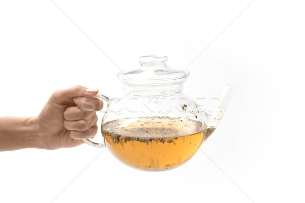 glass teapot with herbal tea in hand Stock photo © LightFieldStudios