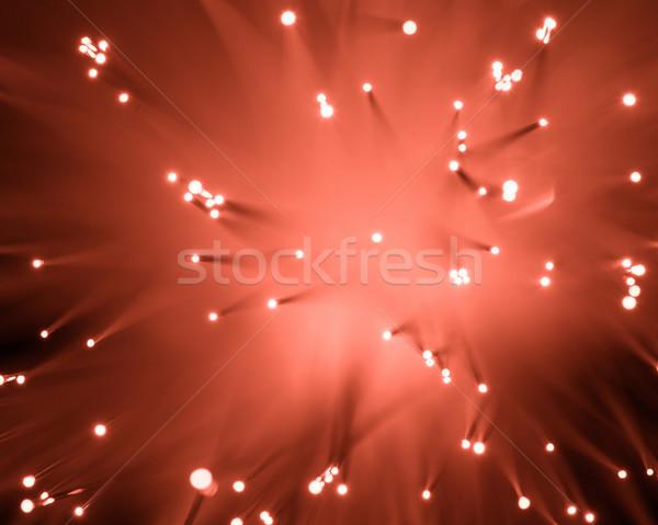 top view of blurred glowing red fiber optics texture  Stock photo © LightFieldStudios