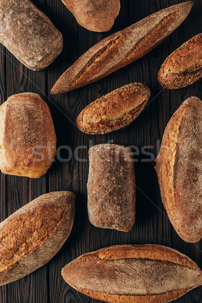 top view of arranged loafs of bread on wooden surface Stock photo © LightFieldStudios