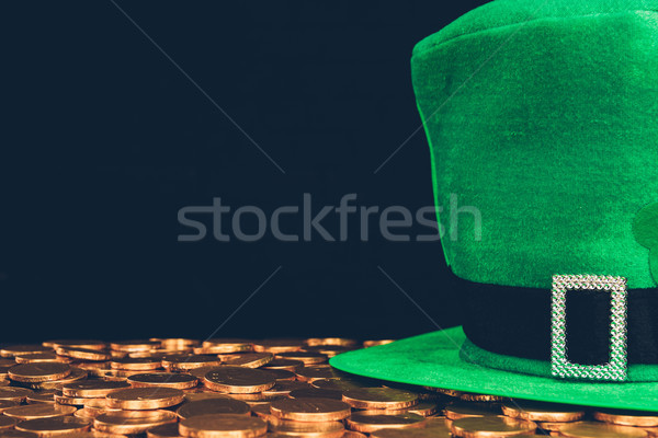 green hat on golden coins isolated on black, st patricks day concept Stock photo © LightFieldStudios