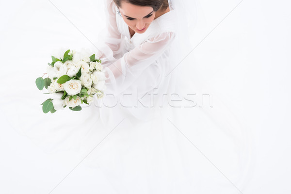 overhead view of bride in traditional dress holding wedding bouquet, isolated on white Stock photo © LightFieldStudios