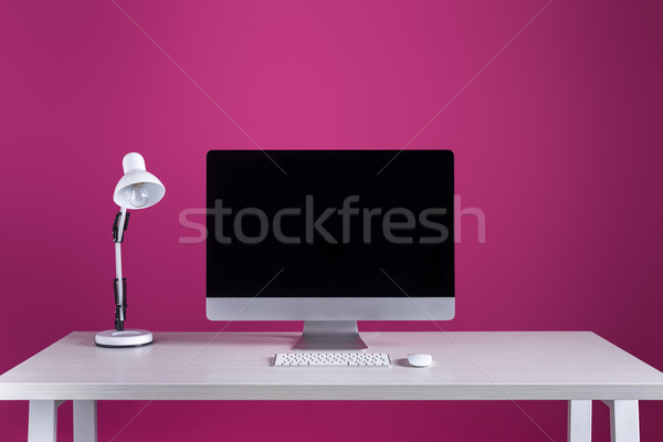 desktop computer with blank screen, keyboard, computer mouse and lamp at workplace Stock photo © LightFieldStudios