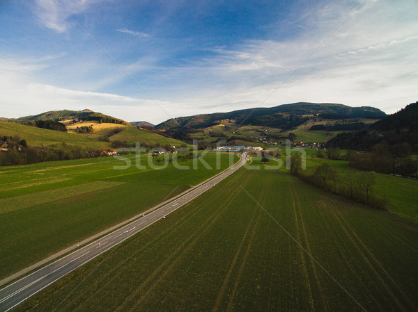 Aerial view of spectacular landscape with road, blue sky and green field, Germany Stock photo © LightFieldStudios