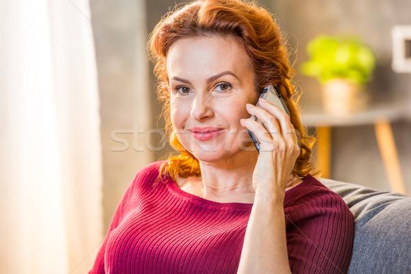 Woman talking on mobile phone Stock photo © LightFieldStudios